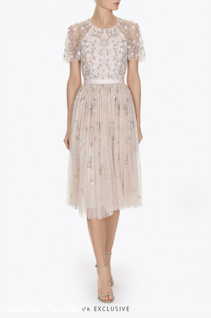 uk exclusive: the starlit midi dress is decorated with a delicate